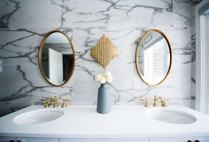 bathroom sink with gold marble work